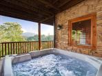 Located on the lower level of the cabin near the game room and home theater is the 8-person hot tub