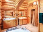 Honeymoon Suite bathroom also features dual vanities and tiled shower with rainfall showerhead
