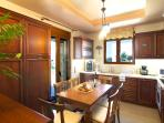 Fully equipped kitchen with direct access to the pool area!