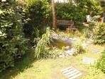 Jardin côté bassin au soleil