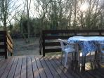 From the verandah you can watch the wildlife.  (The plastic table is now a large wooden one.)