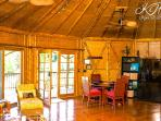 Kitchen and living area are open spaced with vaulted bamboo ceilings