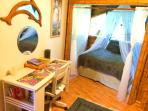 Bedroom has a desk, dressers and private lanai's.
