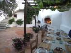 dining under the pergola in the courtyard - inbuilt pizza oven and BBQ grill