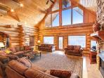 Soaring ceiling, wall of windows and stackedstone fireplace greet you upon arrival at Grand View