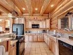 Island with smoothtop electric range and snack bar seating. There are 2 refrigerators!