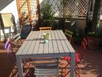 table with 6 chairs on the terrace