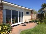 Your private patio overlooking the sea with Beachside Holidays in Norfolk