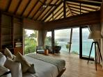 Master Bedroom spills across the ocean... Featuring luxurious King bed, private deck and ensuite