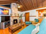 Classic California beach house with hardwood flooring and soaring natural beam ceilings; beautiful exotic wood accents...
