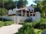 Located in a beautiful mediterranean garden just steps from the sea