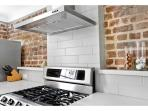 Contemporary subway tile back splash and stainless steal gas stove.