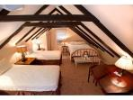 Attic room with one Full and two Twin beds