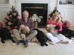 Sue and Johnny (owners) and their three black labs.