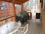 Covered deck with BBQ and plenty of seating