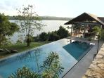 The Beautiful 45ft infinity pool looking over the serene Lake and House.