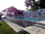 A great view from the garden of the pool and the House