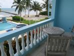 View from your second floor balcony! You can see your private pool and beach among the waving palms!