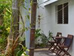 Catch the morning sun or evening moonrise on the patio at the front of Injasuti villa