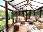 Beautiful conservatory overlooking river and leading to decked area