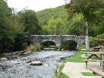 Fingle bridge one of Dartmoor's most visited beauty spot, also enjoy a drink in the pub
