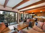Timber Ridge #53 Living Area With Floor To Ceiling Windows And A Wood Burning Fireplace