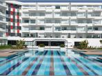 The building, a wonderful example of modern architecture, with swimming pool