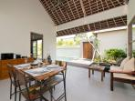 Living and Dining Area with Pool View