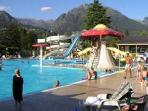 Swimming pool with big slides and baby pool