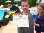Jamie gets his PADI 'bubble maker' certificate after an hour of scuba training in the pool