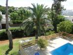 view from private top floor terrace onto pool and garden and hammock
