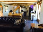 Open plan lounge area. Dining table to seat 6. Chesterfield sofas, Concealed flat screen TV