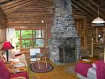 Living space with wood-stove, field-stone fireplace and monitor heater