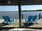 Enjoy your favorite beverage dockside. Watch passing boats, dolphins & pelicans