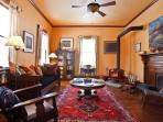 Second parlor room with wood burning stove, TV, stereo and board games.