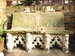 A beautiful gothic bench in an afternoon sun-trap.