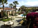 Gardens, pool and guest rooms