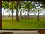 This is the view of the beach and ocean taken from the bed in the Master Bedroom