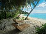 Each bungalow has a private beach area complete with chaise lounge.