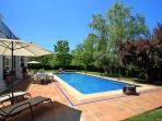 Villa Finca Maridadi has a fifteen metre swimming pool with an ornamental fountain