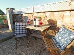1 Bamburgh Gate, enjoy sitting outside with a glass of wine after a day out exploring the area.