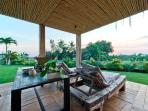 Lounge area at the main entrance to the villa with sunset view