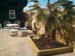 Lovely sunny private garden with outdoor lights, table, BBQ and chiminea.