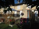 Verdhello cottage fronts onto the main lawn and has an enclosed private outdoor dining area