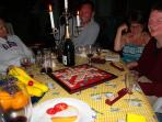 Guests from different cottages get together for a game of scrabble with wine and cheese