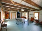game room with ping pong and foose ball