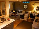 Open plan lounge, kitchen, dining area with real fire and 50' 3D TV DVD player, surround sound