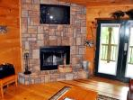 The Wood Burning Fireplace with TV Above