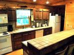 Dine Together at the Bar Right Off Of the Fully Equipped Kitchen