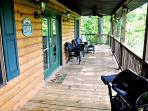 The Covered Porch with Ceiling Fan and Outdoor Seating